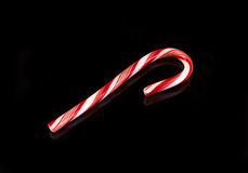 Candy cane on black Royalty Free Stock Photo