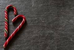 Candy Cane on a black marble background. Royalty Free Stock Images