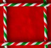 Candy cane border. Candy cane square border on red Christmas stocking royalty free stock image