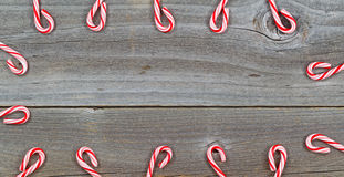 Candy Cane Border on rustic Wood Royalty Free Stock Images