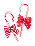 Candy cane with bow. Isolated on white background royalty free stock photo