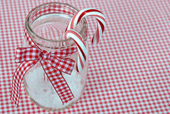 Candy cane in canning jar. Candy canes in canning jar with red and white gingham ribbon Royalty Free Stock Photography