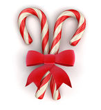Candy Cane and Celebration Bow  (clipping path included) Stock Photos