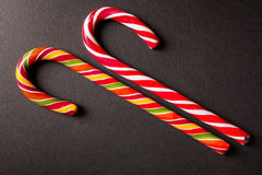 Candy Cane. Christmas candy cane on a dark surface stock photography