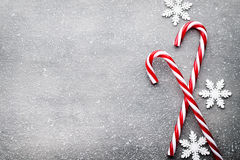 Candy cane. Christmas decors with gray background. stock photos