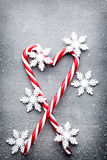 Candy cane. Christmas decors with gray background. royalty free stock photo