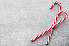 Candy cane. Christmas decors with gray background. stock photo