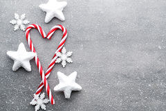 Candy cane. Christmas decors with gray background. Stock Photography