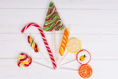 Candy cane and colorful bright different lollipops as fruits and Stock Photo