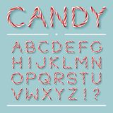 Candy Cane Font - Letters. Candy Cane Font. Bright twisted red and white lollypop letters with light grey shadow isolated on mint background. Uppercase Royalty Free Stock Photo
