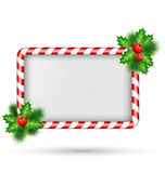 Candy cane frame with holly isolated on white Royalty Free Stock Photos