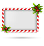 Candy cane frame with holly on white Royalty Free Stock Photography