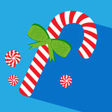 Candy cane with green bow Royalty Free Stock Photos