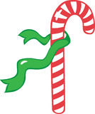 The candy cane with a green ribbon Stock Photo