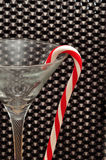 Candy cane hanging in a martini glass Royalty Free Stock Image