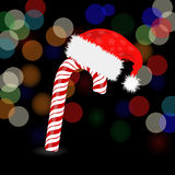 Candy Cane and Hat of Santa Claus Royalty Free Stock Photos