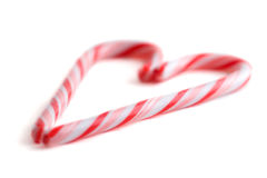 Candy Cane Heart. Two candy canes in a heart shape royalty free stock photography