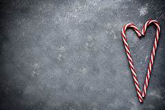 Candy cane heart on gray concrete background Royalty Free Stock Images