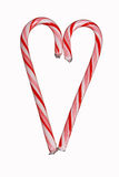 Candy cane heart isolated on white. Two candy canes put together to form a heart shape.   Isolated on a white background Royalty Free Stock Photo