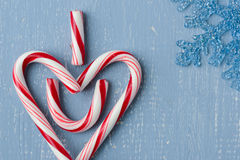 Candy Cane Heart Symbol on Blue Wood with Snowflake Upper Right Side Royalty Free Stock Photography