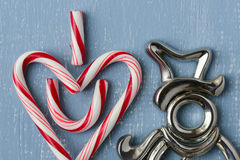 Candy Cane Heart Symbol on Blue Wood with Snowman Stock Photos