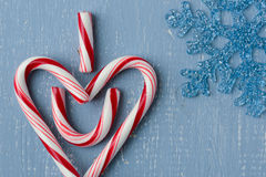 Candy Cane Heart Symbol Saying I heart U on Blue Wood with Snowflake Stock Photography