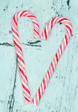 Candy cane heart on a wooden background Stock Images