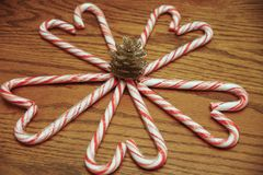 Candy Cane Hearts with a Pine Cone in Center royalty free stock image
