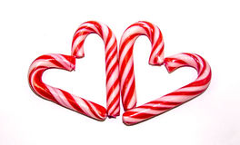 Candy cane hearts. Two hearts made of red and white candy cane sticks royalty free stock photography