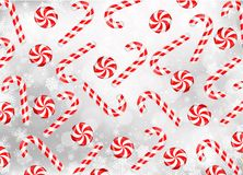 Candy cane and lollipop with snowflakes Royalty Free Stock Image
