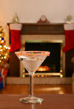 Candy cane martini on wood table Royalty Free Stock Photos