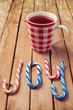 Candy cane and mulled wine over wooden background Royalty Free Stock Photography