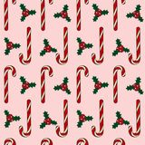 Candy cane on a pink background christmas holly berry leaves mer. Ry christmas pattern seamless vector Stock Photography