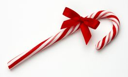 Candy cane with red bow. Shot on white background with soft shadow Royalty Free Stock Image
