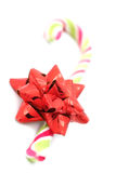 Candy cane with red bow Royalty Free Stock Photos