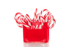 Candy cane in a red box Royalty Free Stock Images