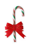 Candy cane with red ribbon Stock Photos