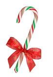 Candy cane with red ribbon Stock Images