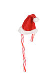 Candy cane and santa hat Royalty Free Stock Photography