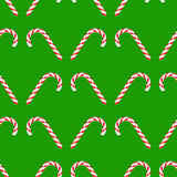 Candy Cane Seamless Pattern. Candy Cane Icon Isolated on Green Background. Christmas Seamless Pattern Stock Images
