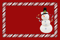 Candy Cane with Snowman Frame Royalty Free Stock Photo