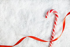 Candy Cane On Snowy Background Stock Photo