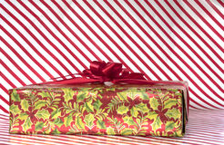 Candy cane stripes background with wrapped gift Royalty Free Stock Photo