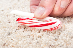 Candy cane stuck to carpet Royalty Free Stock Photos