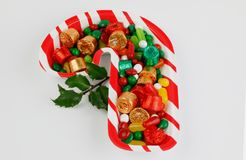 Candy cane table center plate with candies  isolated on white background. Close up candy cane table center plate with candies  isolated on white background Royalty Free Stock Photos