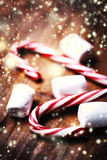 Candy cane with white marshmallows and christmas decoration, win Royalty Free Stock Image
