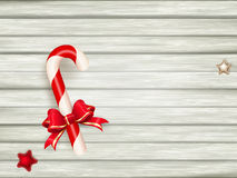 Candy cane on wooden board. EPS 10 Royalty Free Stock Photos