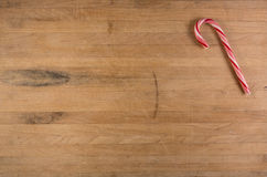 Candy Cane on Worn Cutting Board Royalty Free Stock Photos