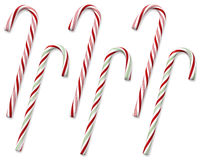 Candy canes. Set of 6 traditional holiday candy canes isolated on white with clipping paths royalty free stock image