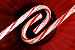 Candy canes. In red glass plate Royalty Free Stock Image